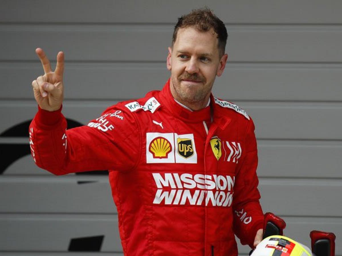 sebastian vettel pisah dengan Ferrari