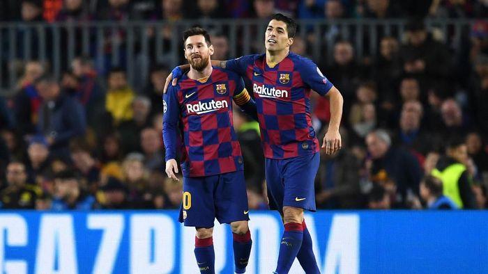 Luis Suarez bersama Lionel Messi